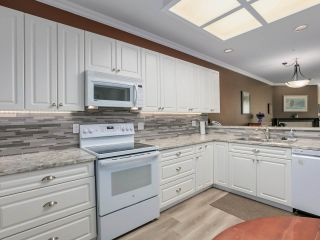 Photo 5: 107 4753 W RIVER Road in Delta: Ladner Elementary Condo for sale (Ladner)  : MLS®# R2455745