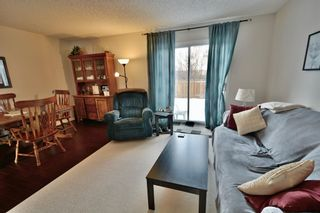 Photo 5: 108 4810 40 Avenue SW in Calgary: Glamorgan Row/Townhouse for sale : MLS®# A1060323