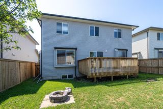 Photo 24: 122 Luxstone Road SW: Airdrie Detached for sale : MLS®# A1129612