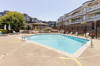 """Photo 26: 217 1850 E SOUTHMERE Crescent in Surrey: Sunnyside Park Surrey Condo for sale in """"SOUTHMERE PLACE"""" (South Surrey White Rock)  : MLS®# R2603585"""