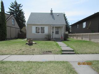 Main Photo: 409 27 Avenue NW in Calgary: Mount Pleasant Detached for sale : MLS®# A1104148