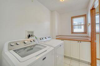 Photo 21: 12 West Hall Place: Cochrane Detached for sale : MLS®# A1119224