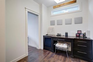 Photo 9: 127 Springbluff Boulevard SW in Calgary: Springbank Hill Detached for sale : MLS®# A1140601
