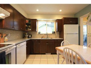 Photo 2: 1906 LODGE PL in Coquitlam: River Springs House for sale : MLS®# V1010766