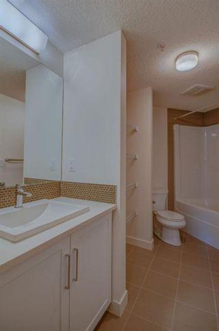 Photo 17: 106 25 Auburn Meadows Avenue SE in Calgary: Auburn Bay Apartment for sale : MLS®# A1124019