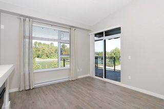 "Photo 3: 305 23285 BILLY BROWN Road in Langley: Fort Langley Condo for sale in ""The Village at Bedford Landing"" : MLS®# R2211106"
