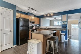 Photo 7: 3168 New Brighton Gardens SE in Calgary: New Brighton Row/Townhouse for sale : MLS®# A1118904