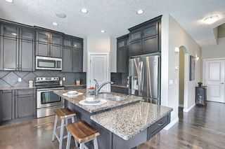 Photo 14: 47 ASPENSHIRE Drive SW in Calgary: Aspen Woods Detached for sale : MLS®# A1106772