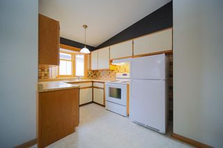 Photo 12: 6219 Louise Road SW in Calgary: Lakeview Detached for sale : MLS®# A1064256