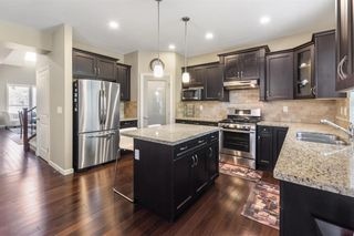 """Photo 13: 6938 208B Street in Langley: Willoughby Heights House for sale in """"MILNER HEIGHTS"""" : MLS®# R2572870"""