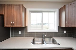 Photo 15: 52 SUNSET Road: Cochrane House for sale : MLS®# C4124887