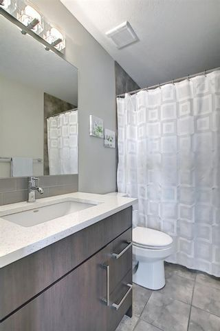 Photo 30: 444 Quarry Way SE in Calgary: Douglasdale/Glen Row/Townhouse for sale : MLS®# A1094767