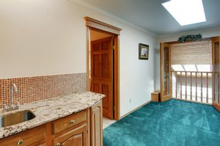 Photo 16: 4 Commerce Street NW in Calgary: Cambrian Heights Detached for sale : MLS®# A1103120