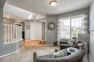 Photo 4: 88 COUGARSTONE Manor SW in Calgary: Cougar Ridge Detached for sale : MLS®# A1022170