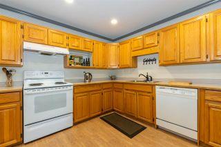"Photo 4: 115 2451 GLADWIN Road in Abbotsford: Central Abbotsford Condo for sale in ""CENTENNIAL COURT"" : MLS®# R2530103"
