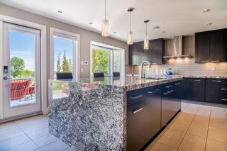 Photo 4: 8956 Bay Ridge Drive SW in Calgary: Bayview Detached for sale : MLS®# A1075239