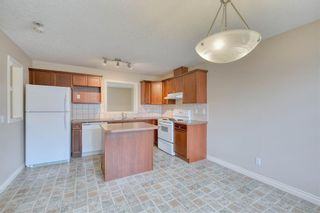 Photo 11: 66 Crystal Shores Cove: Okotoks Row/Townhouse for sale : MLS®# C4305435