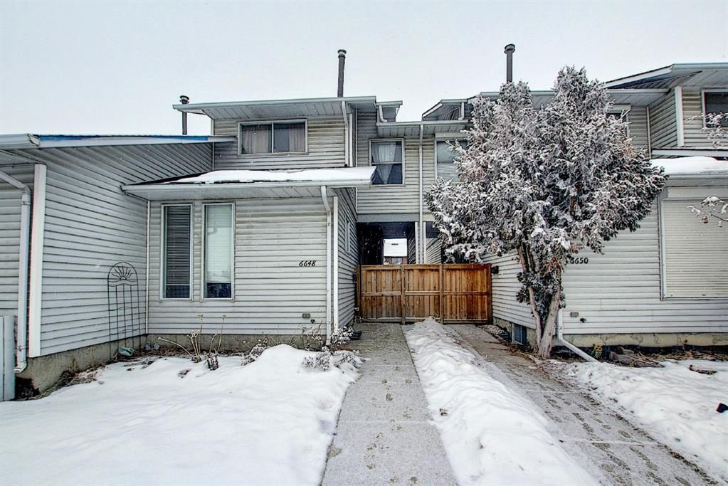 Main Photo: 6648 Temple Drive NE in Calgary: Temple Row/Townhouse for sale : MLS®# A1064641