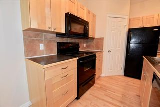 Photo 4: 746 Carriage Lane Drive: Carstairs House for sale : MLS®# C4165692