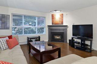 "Photo 3: 105 20200 54A Avenue in Langley: Langley City Condo for sale in ""MONTEREY GRANDE"" : MLS®# F1438210"