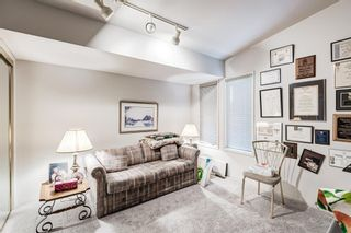 Photo 29: 34 Woodmeadow Close SW in Calgary: Woodlands Semi Detached for sale : MLS®# A1127227