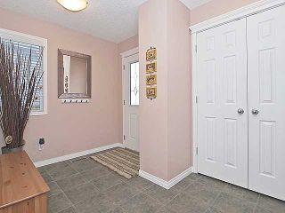Photo 2: 215 EVANSMEADE Common NW in CALGARY: Evanston Residential Detached Single Family for sale (Calgary)  : MLS®# C3554282