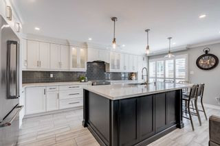 Photo 7: 23 Gartshore Drive in Whitby: Williamsburg House (2-Storey) for sale : MLS®# E5378917