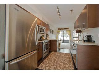 """Photo 4: # 111 1859 STAINSBURY AV in Vancouver: Victoria VE Townhouse for sale in """"THE WORKS @ COMMERCIAL DRIVE"""" (Vancouver East)  : MLS®# V990746"""