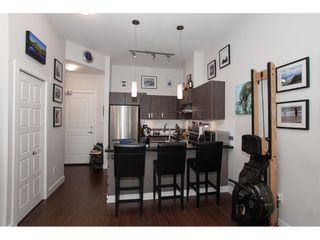 """Photo 7: 416 20219 54A Avenue in Langley: Langley City Condo for sale in """"SUEDE LIVING"""" : MLS®# R2590437"""