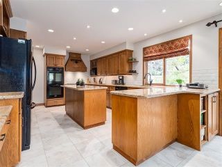 Photo 10: 308 COACH GROVE Place SW in Calgary: Coach Hill House for sale : MLS®# C4064754