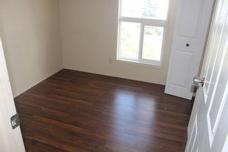 Photo 6: 209 Pennsylvania Road SE in Calgary: Penbrooke Meadows Row/Townhouse for sale : MLS®# A1153130