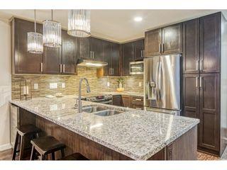 "Photo 7: 403 6480 194 Street in Surrey: Clayton Condo for sale in ""Waterstone"" (Cloverdale)  : MLS®# R2467740"