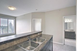Photo 8: 405 1727 54 Street SE in Calgary: Penbrooke Meadows Apartment for sale : MLS®# A1120448