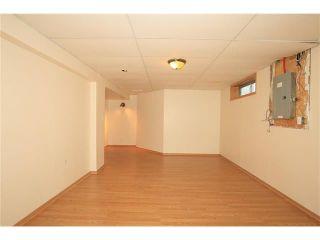 Photo 40: 74 WEST TERRACE Road: Cochrane House for sale : MLS®# C4073559