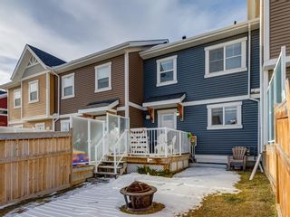 Photo 34: 142 Sunset Road: Cochrane Row/Townhouse for sale : MLS®# A1052095
