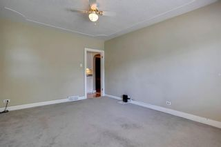 Photo 10: 824 19 Avenue NW in Calgary: Mount Pleasant Detached for sale : MLS®# A1009057