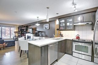 Main Photo: 206 1805 26 Avenue SW in Calgary: South Calgary Apartment for sale : MLS®# A1095931
