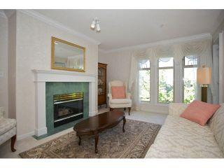 "Photo 5: 401 15340 19A Avenue in Surrey: King George Corridor Condo for sale in ""Stratford Gardens"" (South Surrey White Rock)  : MLS®# F1448318"
