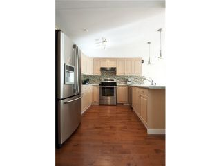 """Photo 3: 20 39754 GOVERNMENT Road in Squamish: Northyards Townhouse for sale in """"MAPLE TREE COURT"""" : MLS®# V1076411"""