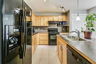 Photo 11: 325 Saddlecrest Way NE in Calgary: Saddle Ridge House  : MLS®# C4149874