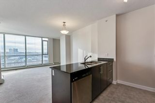Photo 2: 303 325 3 Street SE in Calgary: Downtown East Village Apartment for sale : MLS®# C4222606