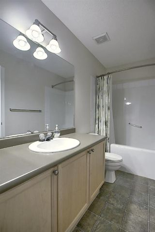 Photo 28: 25 Tuscany Springs Gardens NW in Calgary: Tuscany Row/Townhouse for sale : MLS®# A1053153