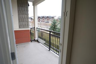 Photo 4: 204 26 VAL GARDENA View SW in Calgary: Springbank Hill Apartment for sale : MLS®# A1045498
