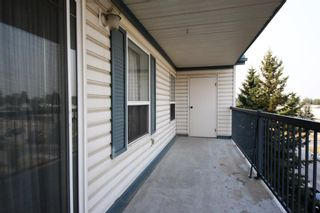 Photo 2: 404 4514 54 Avenue: Olds Apartment for sale : MLS®# A1130006