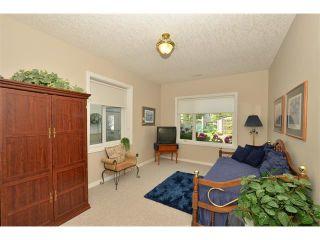 Photo 36: 134 GLENEAGLES View: Cochrane House for sale : MLS®# C4018773