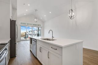 Photo 13: 12562 Crestmont Boulevard SW in Calgary: Crestmont Row/Townhouse for sale : MLS®# A1117892