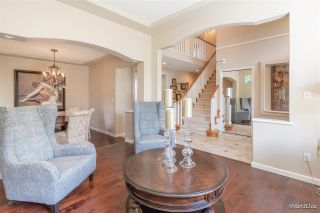 """Photo 3: 7381 146A Street in Surrey: East Newton House for sale in """"Chimney Heights"""" : MLS®# R2593567"""