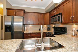 "Photo 13: 204 20286 53A Avenue in Langley: Langley City Condo for sale in ""Casa Verona"" : MLS®# F1428977"