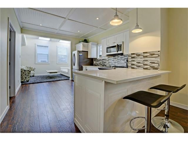 Main Photo: 309 28 AV NE in Calgary: Tuxedo Park House for sale : MLS®# C4066138