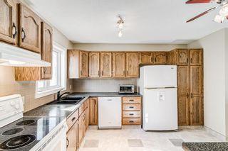 Photo 10: 84 Deerpath Road SE in Calgary: Deer Ridge Detached for sale : MLS®# A1149670